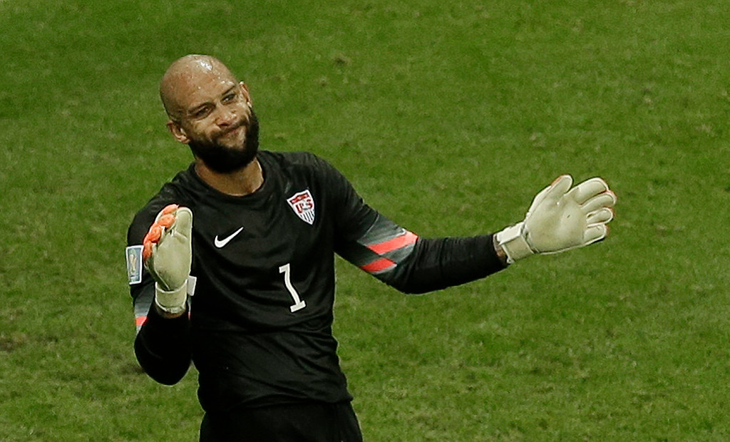 . United States\' goalkeeper Tim Howard gestures to his teammates after making a save during the World Cup round of 16 soccer match between Belgium and the USA at the Arena Fonte Nova in Salvador, Brazil, Tuesday, July 1, 2014. (AP Photo/Themba Hadebe)