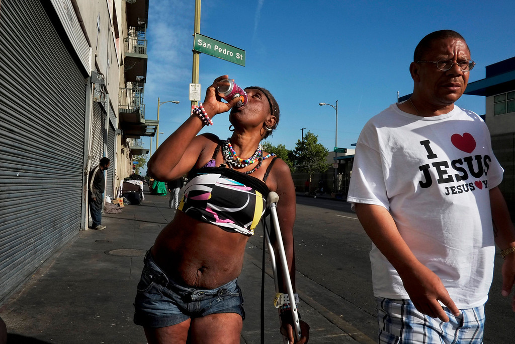 . Antoinette Theus, 45, who says she has been homeless for 30 years, drinks a can of soda in the Skid Row area of Los Angeles, Thursday, April 11, 2013. (AP Photo/Jae C. Hong)