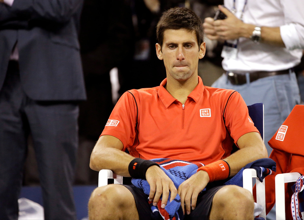 . Novak Djokovic, of Serbia, sits in his changeover chair after losing to Rafael Nadal, of Spain, in the men\'s singles final of the 2013 U.S. Open tennis tournament, Monday, Sept. 9, 2013, in New York. (AP Photo/David Goldman)