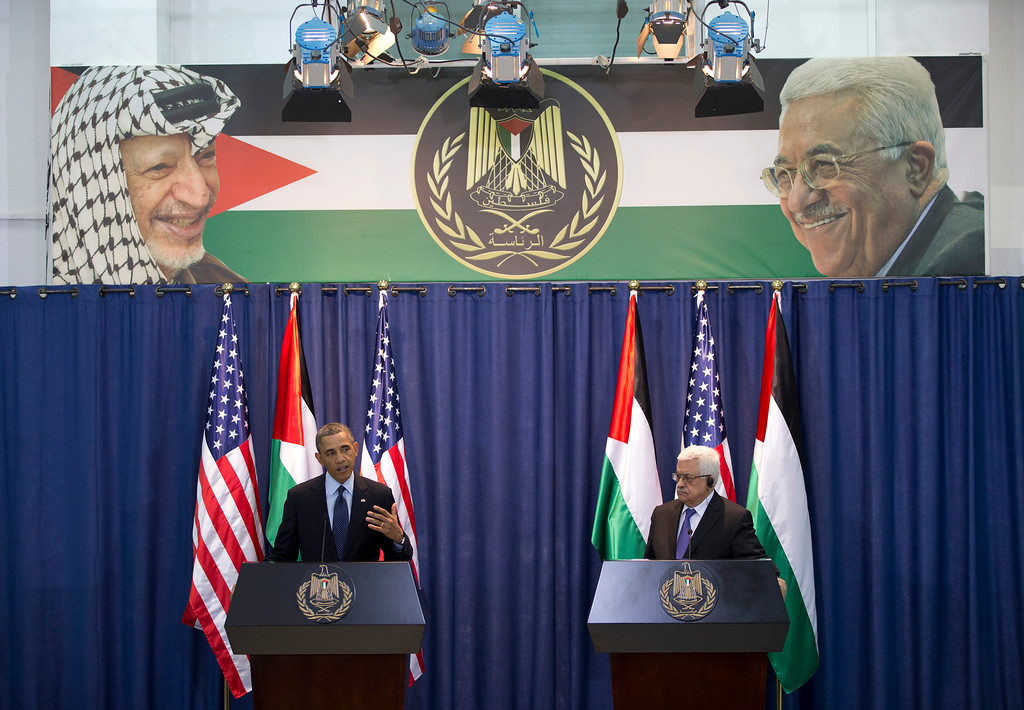 . U.S. President Barack Obama, left, and Palestinian President Mahmoud Abbas participate in a joint news conference at the Muqata Presidential Compound, in the West Bank town of Ramallah, Thursday, March 21, 2013. (AP Photo/Carolyn Kaster)