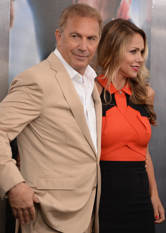 """. Actor Kevin Costner and Christine Baumgartner attend attends the \""""Man Of Steel\"""" world premiere at Alice Tully Hall at Lincoln Center on June 10, 2013 in New York City.  (Photo by Andrew H. Walker/Getty Images)"""
