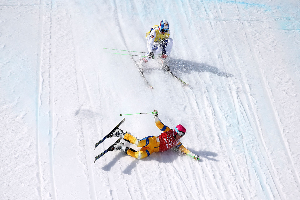 . Victor Oehling Norberg of Sweden crashes to the snow followed by Egor Korotkov of Russia during the Freestyle Skiing Men\'s Ski Cross Quarter Finals on day 13 of the 2014 Sochi Winter Olympic at Rosa Khutor Extreme Park on February 20, 2014 in Sochi, Russia.  (Photo by Streeter Lecka/Getty Images)