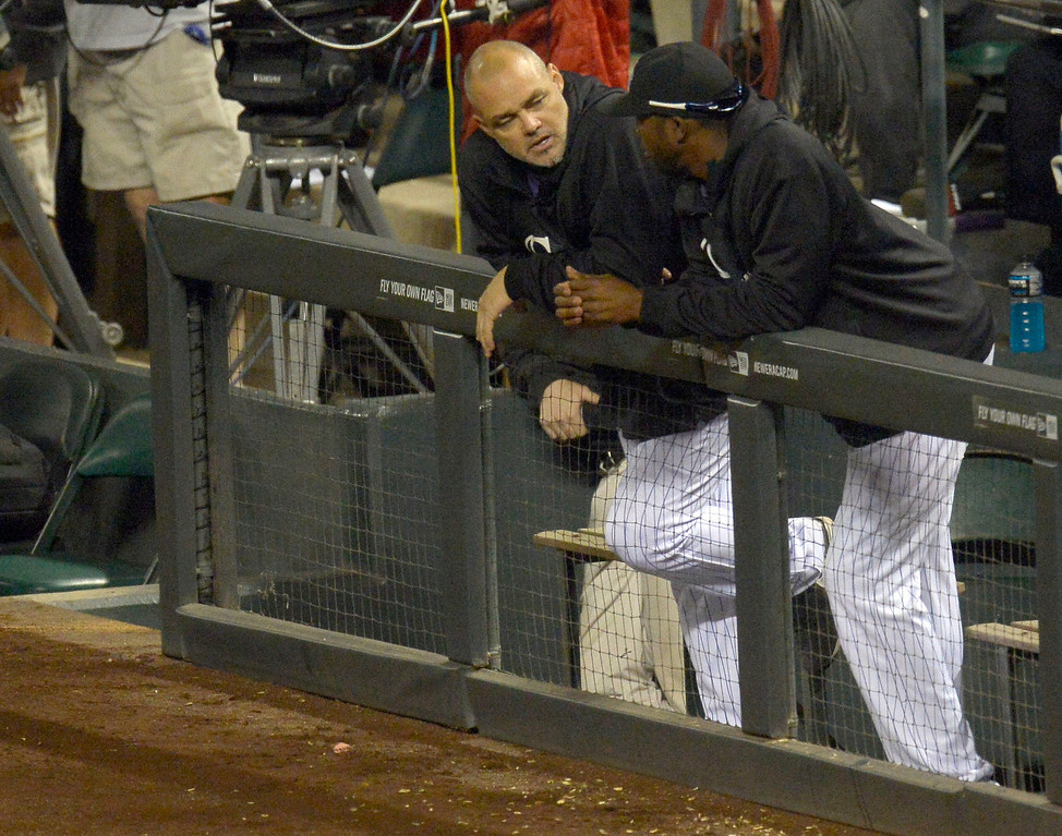 . DENVER, CO. - SEPTEMBER 24: Colorado Rockies hitting coach Dante Bichette chats with Dexter Fowler (24) of the Colorado Rockies September 24, 2013 at Coors Field. Bichette announced he will resign as the teams hitting coach. (Photo by John Leyba/The Denver Post)