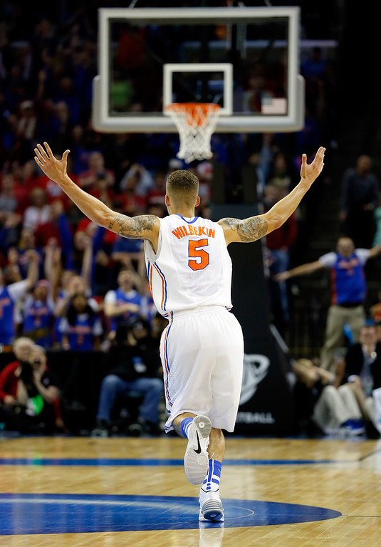 . Scottie Wilbekin #5 of the Florida Gators celebrates after hitting a three pointer to end the first half against the Dayton Flyers during the south regional final of the 2014 NCAA Men\'s Basketball Tournament at the FedExForum on March 29, 2014 in Memphis, Tennessee.  (Photo by Kevin C. Cox/Getty Images)