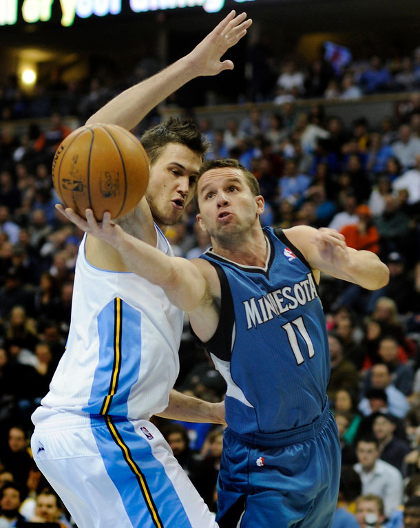 . Wolves guard Jose Barea (11) reached around Denver forward Danilo Gallinari (8) for a shot in the second quarter. The Denver Nuggets hosted the Minnesota Timberwolves at the Pepsi Center Thursday night, January 3, 2013. Karl Gehring/The Denver Post