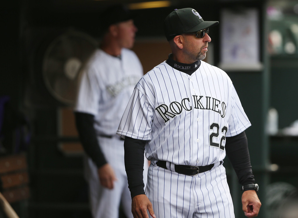 . Colorado Rockies manager Walt Weiss looks on against the Arizona Diamondbacks in the eighth inning of the Diamondbacks\' 5-3 victory in a baseball game in Denver on Sunday, April 6, 2014. (AP Photo/David Zalubowski)