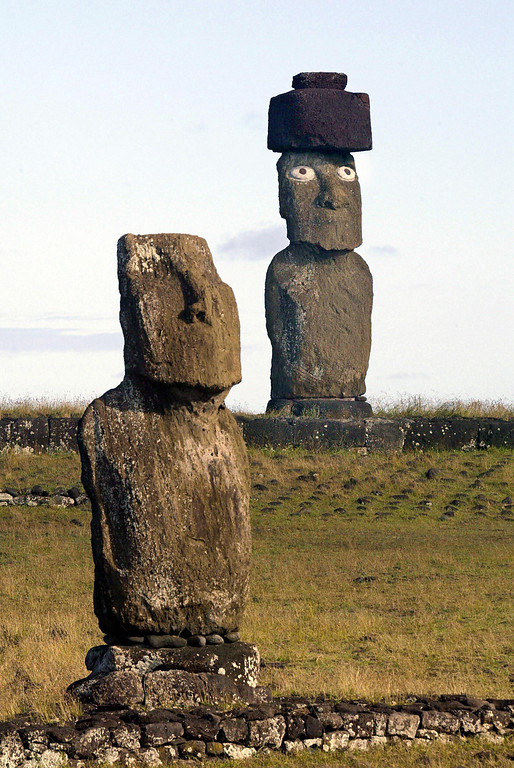 . A photo taken 12 February 2005 on the Easter Island, Chile, shows two Moais sculptures including the one that has been restored at right. Mistreated for centuries by tribal wars, pro-slavers and adventurers, the 3800 residents of the island fight to keep their originality coping with the thousands of tourists coming every year.  MARTIN BERNETTI/AFP/Getty Images