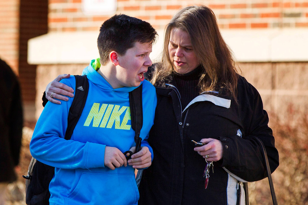 . A boy weeps as he is told what happened after being picked up at Reed Intermediate School following a shooting at Sandy Hook Elementary School in Newtown, Connecticut, December 14, 2012. A heavily armed gunman opened fire on school children and staff at a Connecticut elementary school on Friday, killing 26 people including 18 children in the latest in a series of shooting rampages that have tormented the United States this year, U.S. media reported. REUTERS/Lucas Jackson