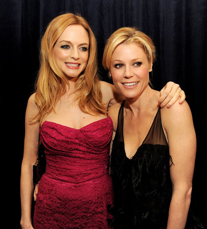""". Actresses Heather Graham (L) and Julie Bowen arrive at \""""An Evening\"""" benifiting The L.A. Gay & Lesbian Center at the Beverly Wilshire Hotel on March 21, 2013 in Beverly Hills, California.  (Photo by Kevin Winter/Getty Images)"""