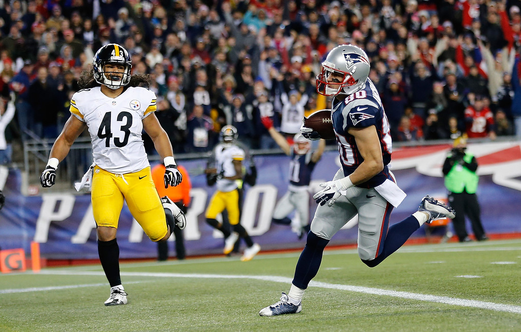. Danny Amendola #80 of the New England Patriots scores a touchdown by Troy Polamalu #43 of the Pittsburgh Steelers in the first quarter during a game at Gillette Stadium on November 3, 2013 in Foxboro, Massachusetts. (Photo by Jim Rogash/Getty Images)