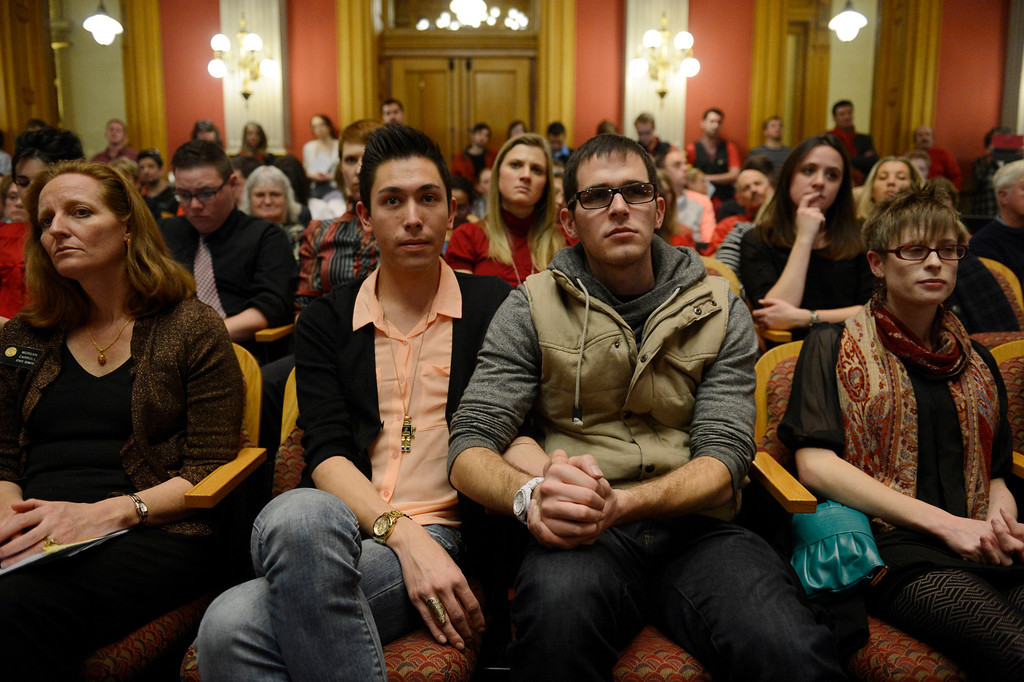 . Denver, CO. - January 23: 20 year old Marvin Garcia IV holds hands with his partner, 22-year-old Kendall B. Rice  as they listen to the Senate Judiciary Committee hear testimony on Senate Bill 11 at the Denver State Capitol. The couple have been together for almost two years and would take advantage of the bill passing to form a civil union.  Denver, Colorado January 23, 2013. (Photo By Joe Amon / The Denver Post)