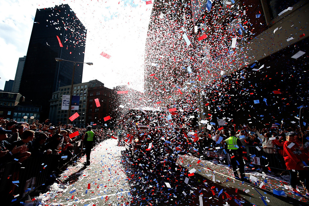 . BOSTON, MA - NOVEMBER 02:  Boston Red Sox fans cheer during the World Series victory parade on November 2, 2013 in Boston, Massachusetts.  (Photo by Jared Wickerham/Getty Images)