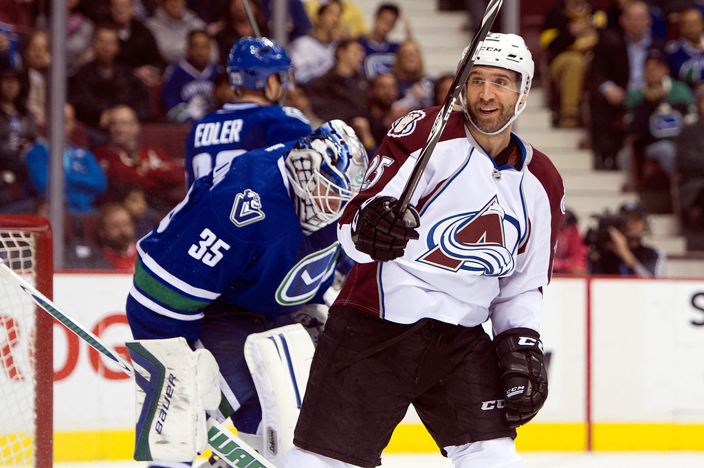 . Max Talbot #25 of the Colorado Avalanche celebrates after teammate Tyson Barrie\'s (not picutred) scored a goal on goalie Jacob Markstrom #35 of the Vancouver Canucks during the third period in NHL action on April 10, 2014 at Rogers Arena in Vancouver, British Columbia, Canada.  (Photo by Rich Lam/Getty Images)