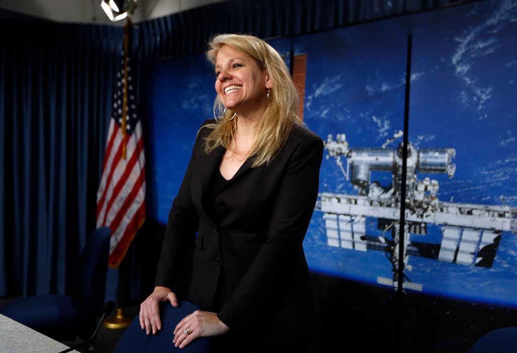 . SpaceX President Gwynne Shotwell smiles after a news conference at the Kennedy Space Center in Cape Canaveral, Florida February 28, 2013. A SpaceX Falcon 9 rocket, with the Dragon capsule, is scheduled for launch on a second resupply mission to the International Space Station on March 1.  REUTERS/Scott Audette