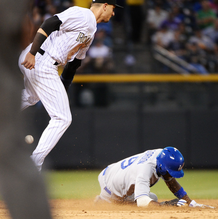 . DENVER JUNE 06: Dee Gordon of Los Angeles Dodgers (9), bottom, steals the 2nd base from Troy Tulowitzki of Colorado Rockies (2) during the game at Coors Field in Denver, Colorado June 6, 2014. (Photo by Hyoung Chang/The Denver Post)
