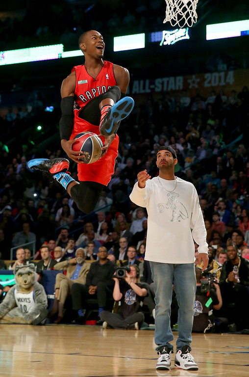 . NEW ORLEANS, LA - FEBRUARY 15:  Eastern Conference All-Star Terrence Ross #31 of the Toronto Raptors takes the ball from Drake during the Sprite Slam Dunk Contest 2014 as part of the 2014 NBA All-Star Weekend at the Smoothie King Center on February 15, 2014 in New Orleans, Louisiana. (Photo by Ronald Martinez/Getty Images)