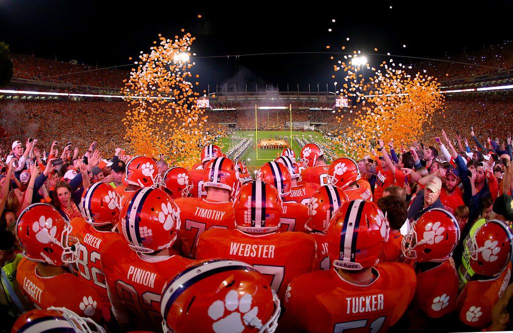 . CLEMSON, SC - OCTOBER 19:  The Clemson Tigers enter the stadium before their game against the Florida State Seminoles at Memorial Stadium on October 19, 2013 in Clemson, South Carolina.  (Photo by Streeter Lecka/Getty Images)