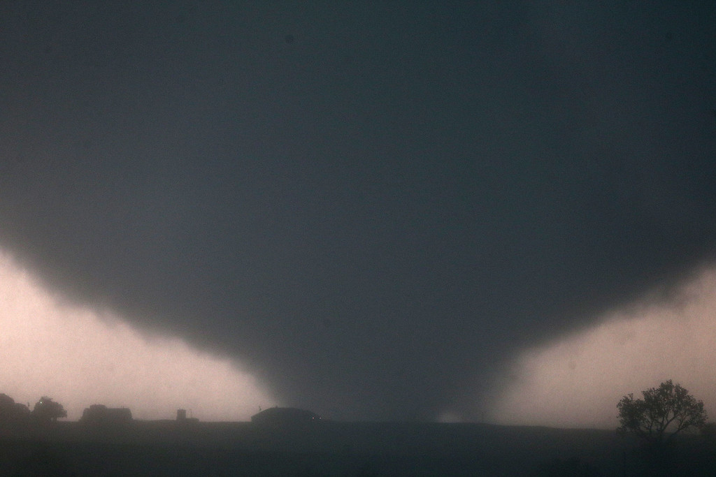 . A tornado touches down near El Reno, Okla., Friday, May 31, 2013, causing damage to structures and injuring travelers on Interstate 40. I-40 has been closed after severe weather rolled through the area. (AP Photo/The Omaha World-Herald, Chris Machian)