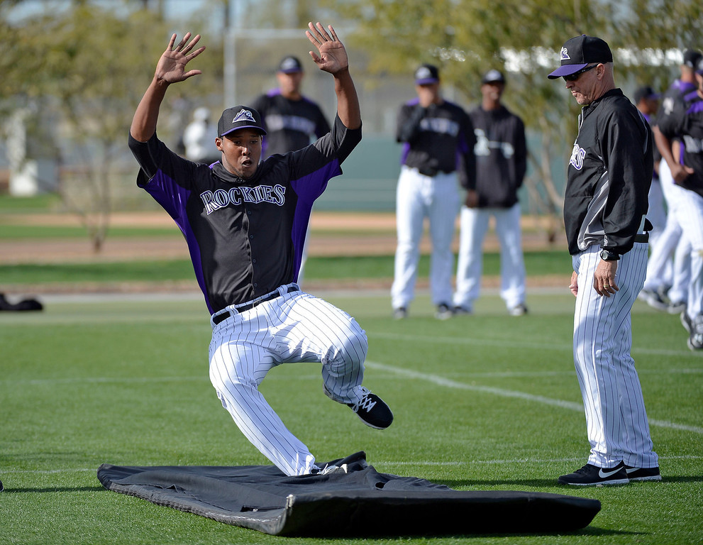 . SCOTTSDALE, AZ. - FEBRUARY 19: Colorado Rockies Juan Nicasio (44) practices his sliding technique during Spring Training February 19, 2013 in Scottsdale. (Photo By John Leyba/The Denver Post)