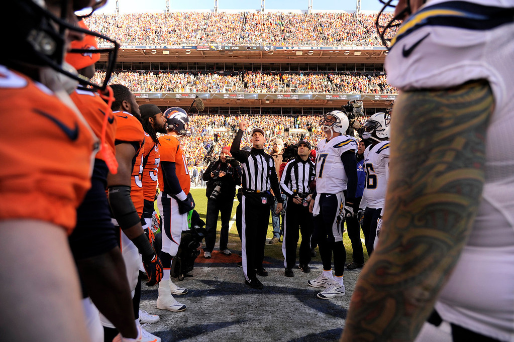 . Denver Broncos quarterback Peyton Manning (18) and San Diego Chargers quarterback Philip Rivers (17) watch as the coin is tossed at the start of the game. The Denver Broncos vs. The San Diego Chargers in an AFC Divisional Playoff game at Sports Authority Field at Mile High in Denver on January 12, 2014. (Photo by John Leyba/The Denver Post)
