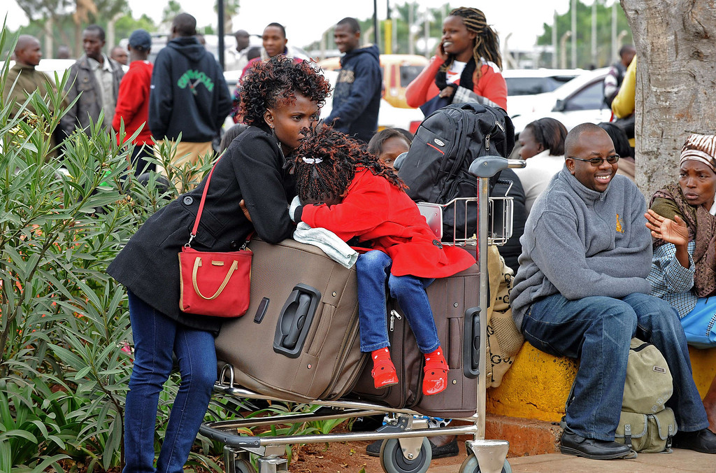 . Stranded passengers wait outside the Jomo Kenyatta International Airport in Nairobi on August 7, 2013.  AFP PHOTO /StringerSTRINGER/AFP/Getty Images