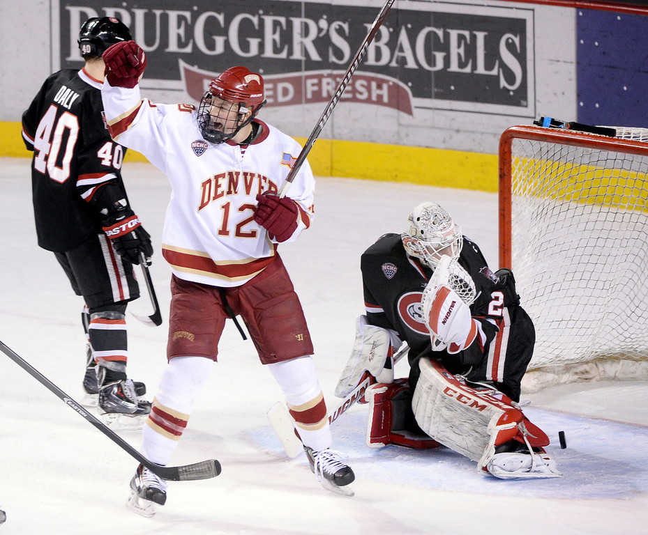 . DENVER, CO. - JANUARY 10: Denver wing Ty Loney (12) reacted after teammate Joey LaLeggia slapped the puck through traffic and into the net late in the second period. The University of Denver hockey team hosted St. Cloud State at Magness Arena Friday night, January 10, 2014. Photo By Karl Gehring/The Denver Post