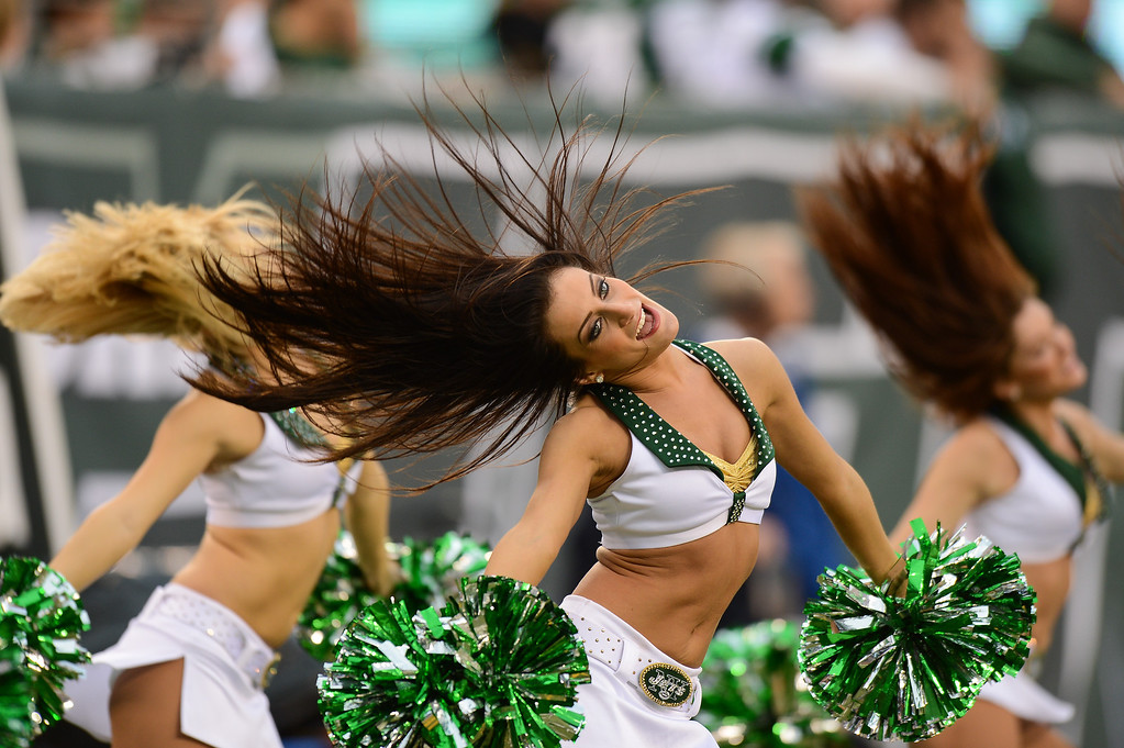 . EAST RUTHERFORD, NJ - DECEMBER 22:  New York Jets cheerleaders perform during the first half of the game against the Cleveland Browns at MetLife Stadium on December 22, 2013 in East Rutherford, New Jersey. (Photo by Ron Antonelli/Getty Images)