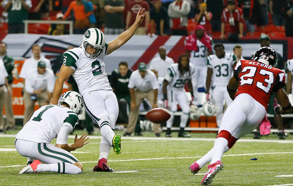 . Nick Folk #2 of the New York Jets kicks the game-winning field goal as time expired against the Atlanta Falcons at Georgia Dome on October 7, 2013 in Atlanta, Georgia.  (Photo by Kevin C. Cox/Getty Images)