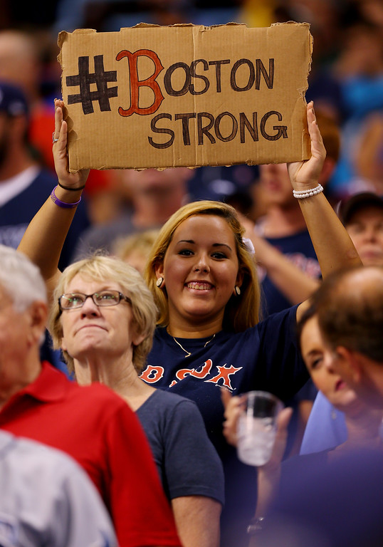 . A Boston Red Sox holds up a sign during Game Four of the American League Division Series against the Tampa Bay Rays at Tropicana Field on October 8, 2013 in St Petersburg, Florida.  (Photo by Mike Ehrmann/Getty Images)