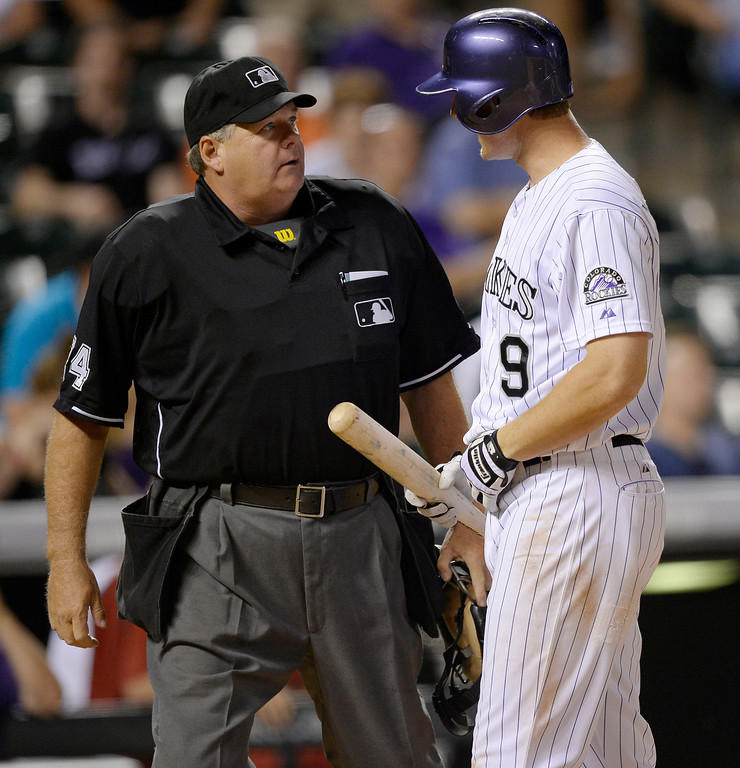 . Colorado Rockies DJ LeMahieu (9) argues his called out on strikes for the last out in the 9th with Home plate umpire Jerry Layne. He later slammed his bat down. The Arizona Diamondbacks defeat the Rockies 4-2 June 3, 2014 at Coors Field.  (Photo by John Leyba/The Denver Post)