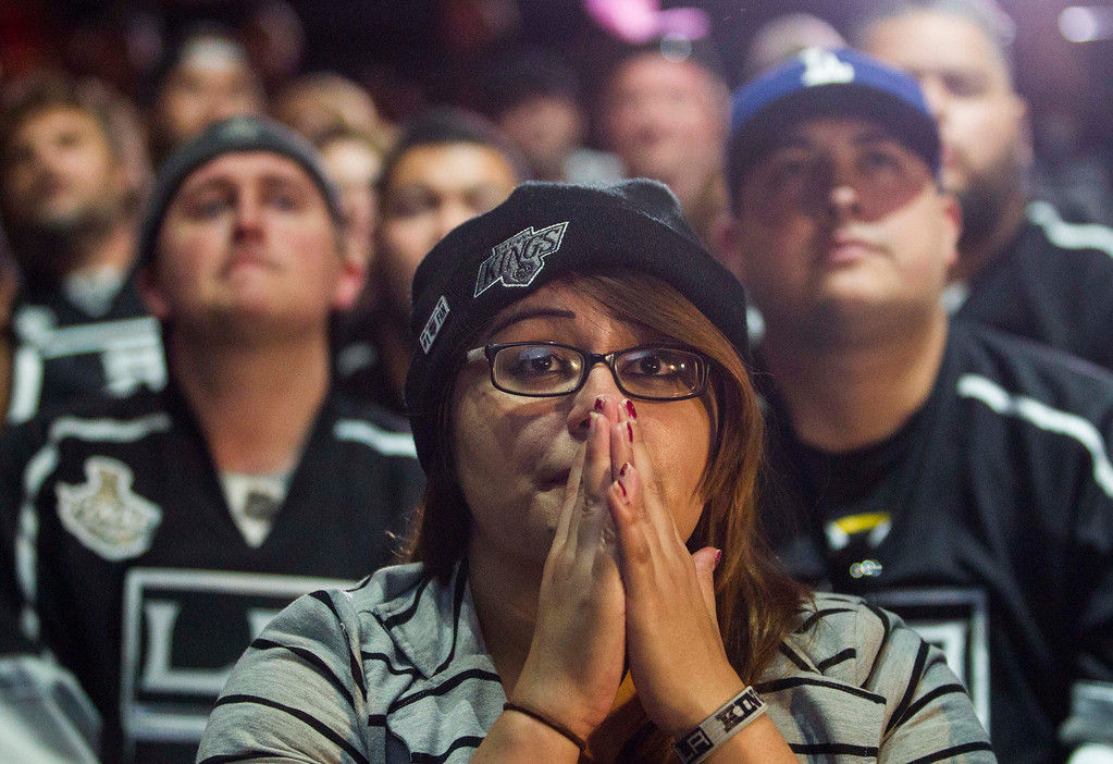 . Los Angeles Kings fans react at Club Nokia at L.A. LIVE as they watch Game 4 of the NHL hockey Stanley Cup Finals against the New York Rangers, Wednesday, June 11, 2014. The Rangers defeated the Kings 2-1. (AP Photo/Ringo H.W. Chiu)