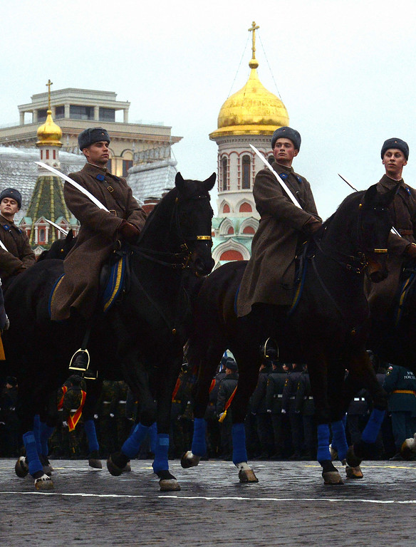 . Wearing the WWII-era Red Army uniform mounted Russian soldiers ride during in a military parade at the Red Square in Moscow, on November 7, 2013. This week Russia marks the 72nd anniversary of the November 7, 1941, parade, when Red Army troops marched past the Kremlin and then went directly to the front line to fight the Nazi Germany troops at the gates of the Russian capital. VASILY MAXIMOV/AFP/Getty Images