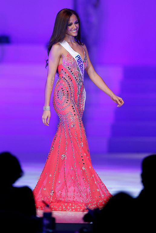 . Miss Puerto Rico Ashley Beth Perez Calderon presents her traditional costume during the final of the 53rd Miss International Beauty Pageant in Tokyo Tuesday, Dec. 17, 2013. (AP Photo/Shizuo Kambayashi)