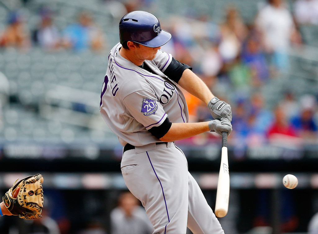 . DJ LeMahieu #9 of the Colorado Rockies connects on a first inning base hit against the New York Mets at Citi Field on August 8, 2013 in the Flushing neighborhood of the Queens borough of New York City.  (Photo by Jim McIsaac/Getty Images)