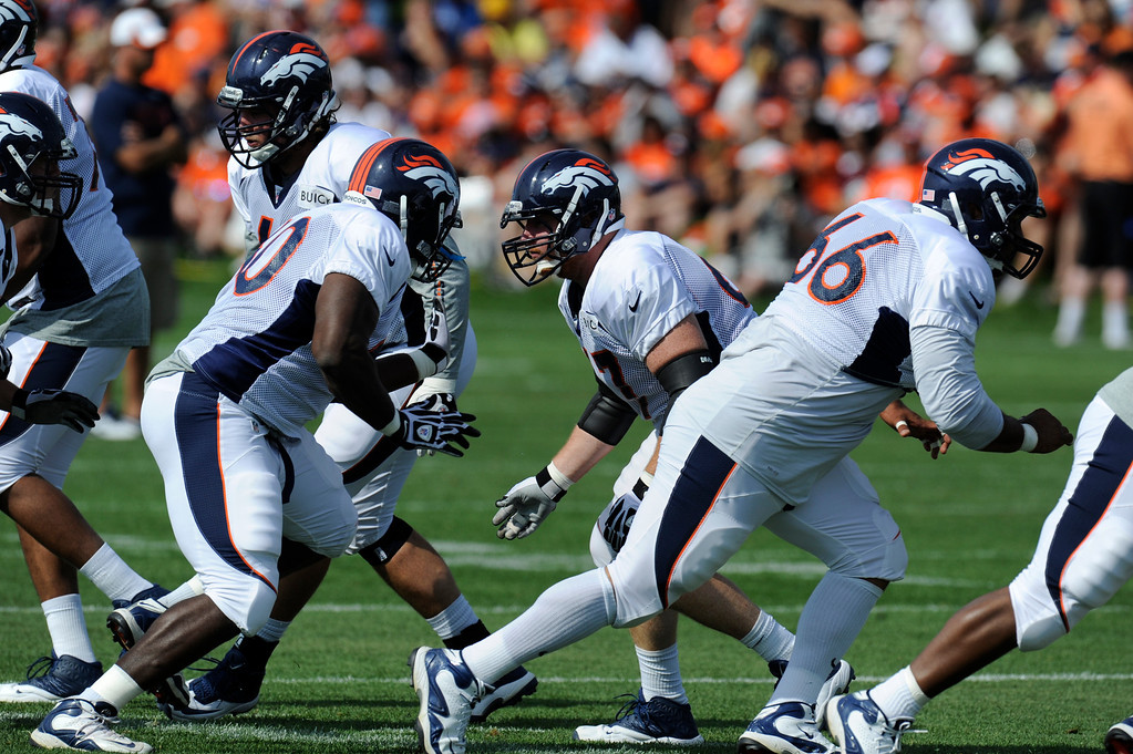 . ENGLEWOOD, CO - JULY 27: Denver Broncos offensive line during training camp at Dove Valley Saturday July 26, 2013.  (Photo By Andy Cross/The Denver Post)