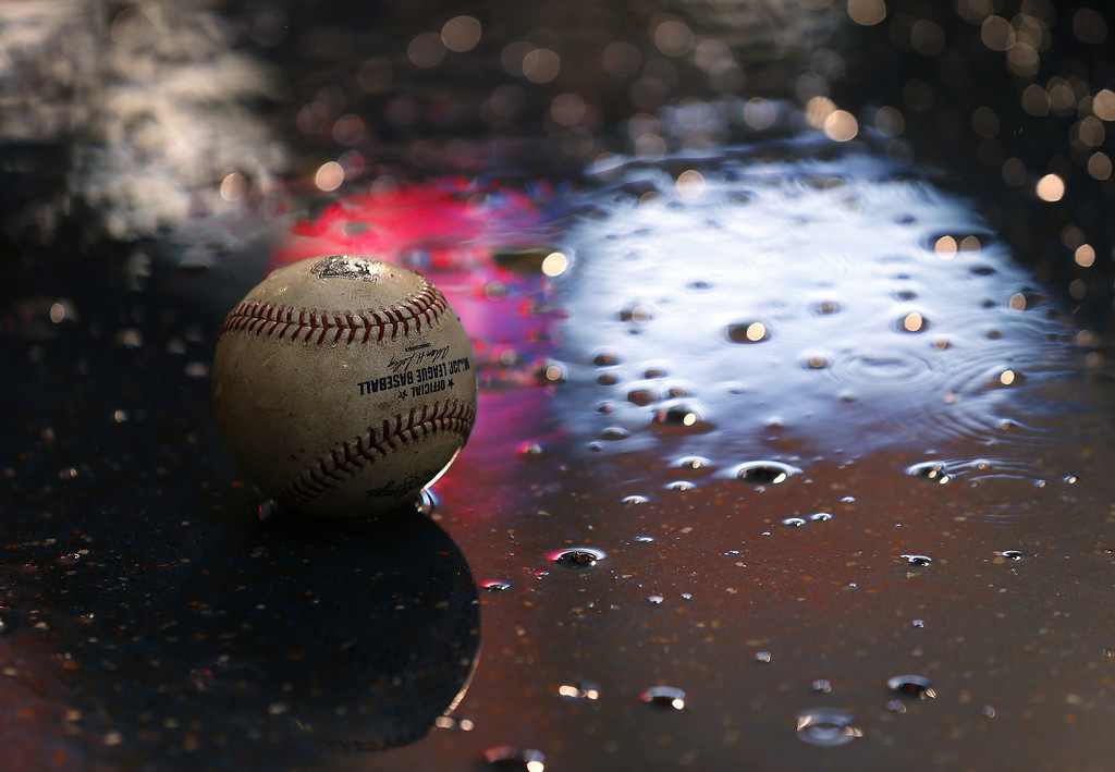 . A baseball sits on the floor of the Colorado Rockies dugout during a rain delay before the start of their game against the Philadelphia Philliesat Citizens Bank Park on May 27, 2014 in Philadelphia, Pennsylvania. (Photo by Rich Schultz/Getty Images)