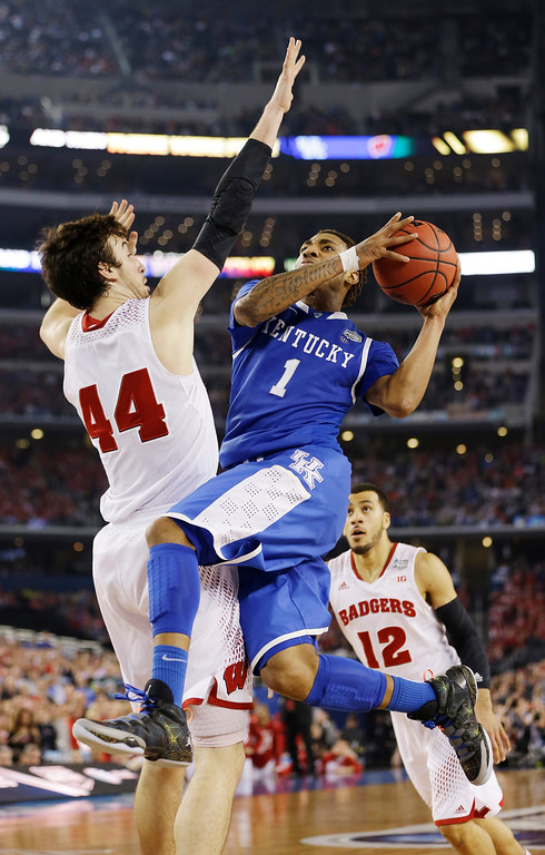 . Kentucky guard James Young (1) shoots as Wisconsin forward Frank Kaminsky (44) defends during the second half of the NCAA Final Four tournament college basketball semifinal game Saturday, April 5, 2014, in Arlington, Texas. (AP Photo/David J. Phillip)