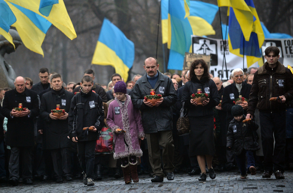 . Ukrainians carry wreaths and flowers on November 23, 2013 during a march of thousands in memory of the victims of the Holodomor famine before a ceremony at the Holodomor memorial in Kiev.  AFP PHOTO/ SERGEI  SUPINSKY/AFP/Getty Images