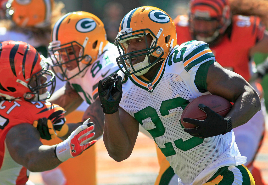 . Green Bay Packers running back Johnathan Franklin (23) runs for a two yard touchdown in the second half of an NFL football game against the Cincinnati Bengals, Sunday, Sept. 22, 2013, in Cincinnati. (AP Photo/Tom Uhlman)
