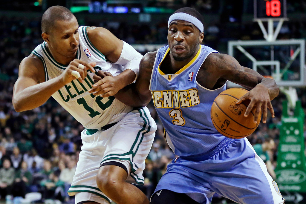 . Denver Nuggets point guard Ty Lawson (3) drives against Boston Celtics guard Leandro Barbosa (12) during the fourth quarter of an NBA basketball game in Boston, Sunday, Feb. 10, 2013. The Celtics won 118-114 in triple-overtime. (AP Photo/Elise Amendola)