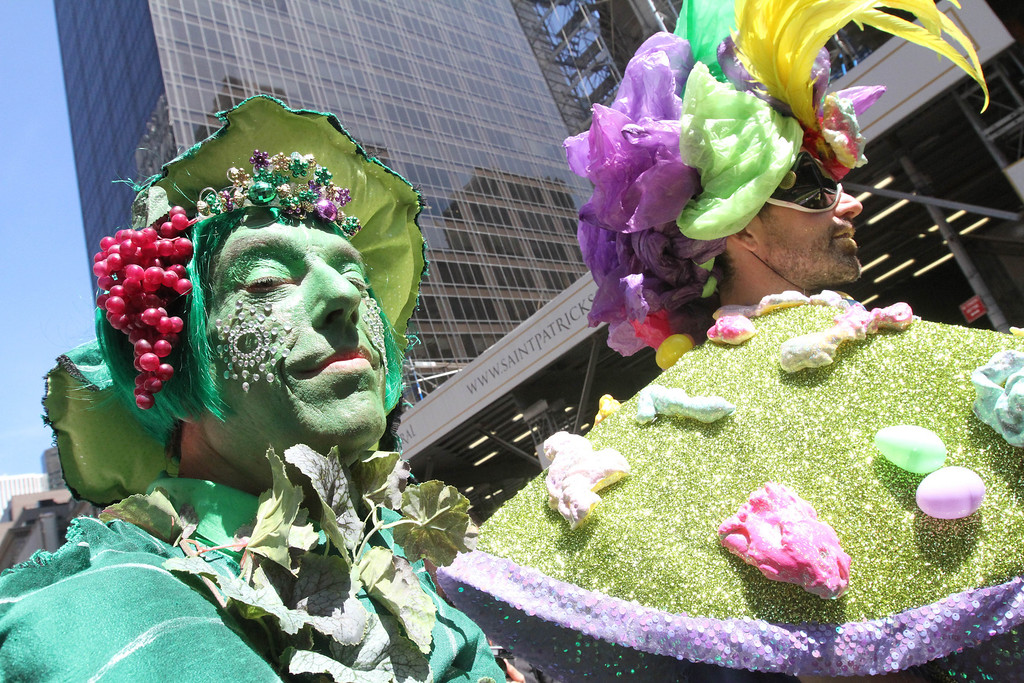 . Dressed for the occasion, Paul Nagle, left, poses for photographs as he takes take part in the Easter Parade along New York\'s Fifth Avenue, Sunday, April 20, 2014. (AP Photo/Tina Fineberg)