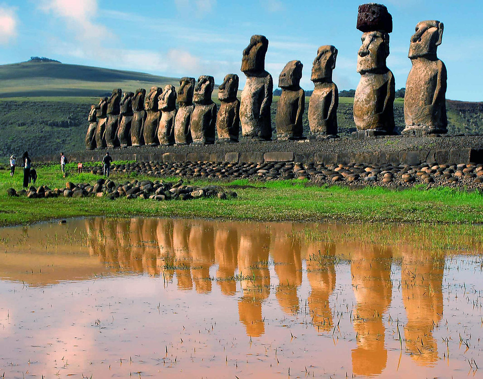 """. In this Feb. 2007 file photo, giant volcanic rock statues called Moais are shown on Easter Island in the South Pacific. Easter Island is Earth\'s most remote inhabited land, a South Pacific speck of volcanic rock so isolated the locals call it \""""Te Pito O Te Henua,\"""" or \""""The Navel of the World.\""""  (AP Photo/La Tercera, File)"""