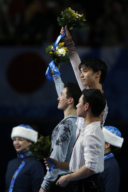 . (From L) Canada\'s silver medalist Patrick Chan (L), Japan\'s gold medalist Yuzuru Hanyu and Kazakhstan\'s bronze medalist Denis Ten pose on the podium during the Men\'s Figure Skating Flower Ceremony at the Iceberg Skating Palace during the Sochi Winter Olympics on February 14, 2014.  (ADRIAN DENNIS/AFP/Getty Images)