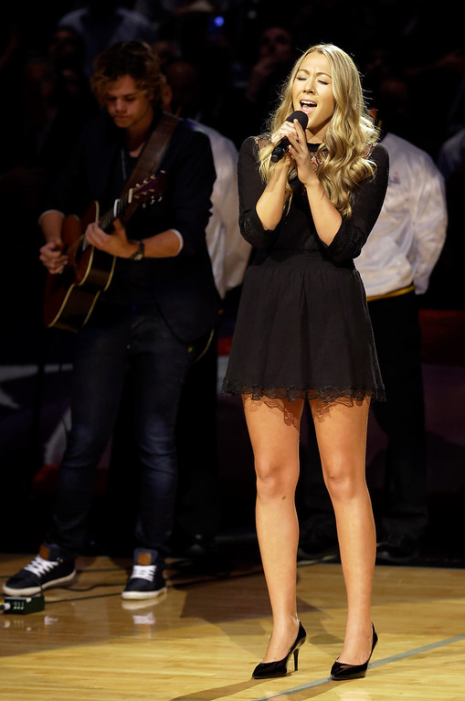 . Colbie Caillat sings the national anthem before Game 5 of the NBA basketball finals between the San Antonio Spurs and the Miami Heat on Sunday, June 15, 2014, in San Antonio. (AP Photo/David J. Phillip)