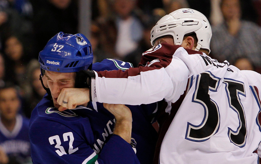 . Vancouver Canucks\' Dale Weise (L) gets punched in the face by Cody McLeod of the Colorado Avalanche during the first period of their NHL hockey game in Vancouver, British Columbia January 30, 2013. REUTERS/Ben Nelms