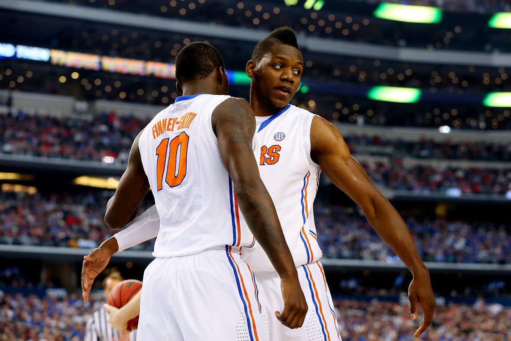 . ARLINGTON, TX - APRIL 05: Dorian Finney-Smith #10 and Will Yeguete #15 of the Florida Gators celebrate against the Connecticut Huskies during the NCAA Men\'s Final Four Semifinal at AT&T Stadium on April 5, 2014 in Arlington, Texas.  (Photo by Ronald Martinez/Getty Images)