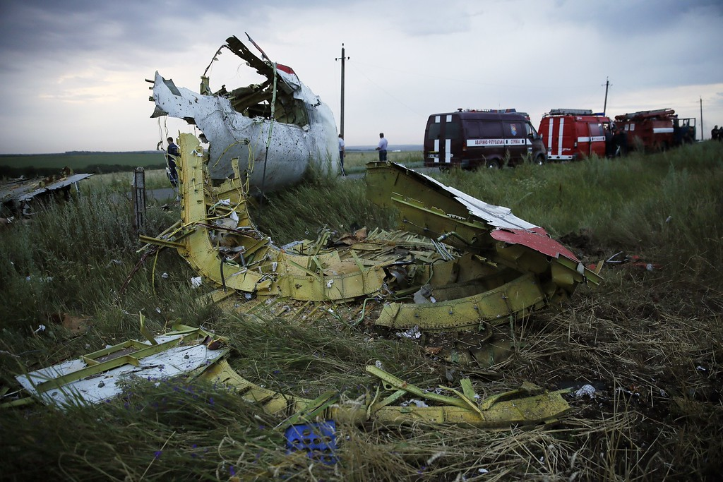 """. A picture taken near the town of Shaktarsk, in rebel-held east Ukraine, on July 17, 2014 shows the wreckages of the Malaysian airliner carrying 295 people from Amsterdam to Kuala Lumpur after it crashed. Malaysia Airlines said today it had \""""lost contact\"""" with one of its passenger planes carrying 295 people over eastern Ukraine, amid speculation it had been shot down. AFP PHOTO / ITAR-TASS /ZURAB DZHAVAKHADZE/AFP/Getty Images"""