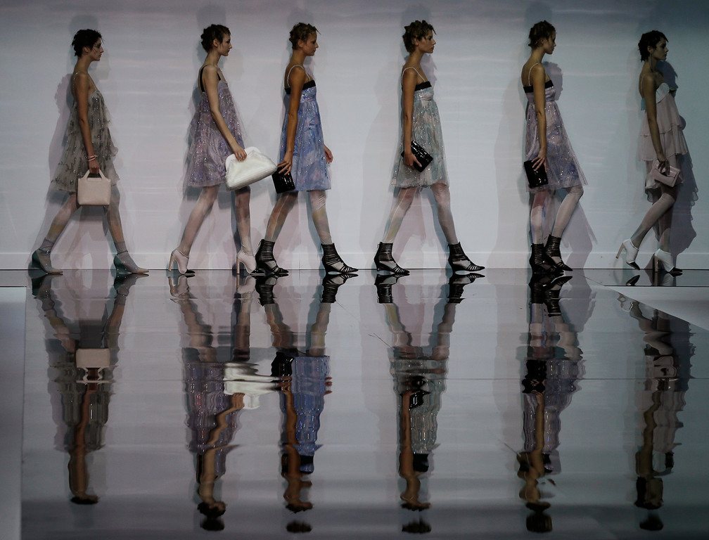 . Models wear creations for Emporio Armani women\'s Spring-Summer 2014 collection, part of the Milan Fashion Week, unveiled in Milan, Italy, Friday, Sept. 20, 2013. (AP Photo/Luca Bruno)