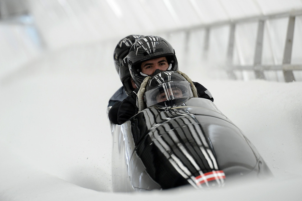 . Austria-1 four-man bobsleigh, steered by Benjamin Maier, takes the brakes during a training session at the Sanki Sliding Center in Rosa Khutor during the Sochi Winter Olympics on February 20, 2014. LIONEL BONAVENTURE/AFP/Getty Images