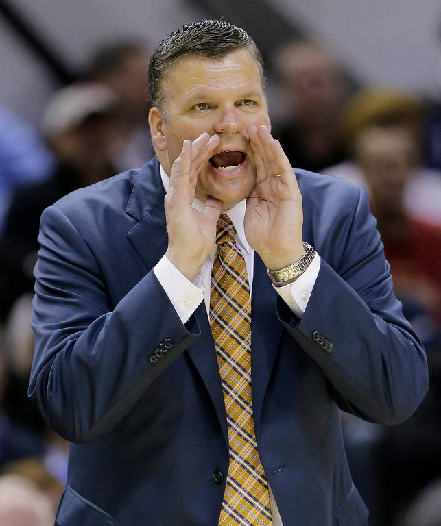 . Creighton coach Greg McDermott shouts from the sideline against Baylor during the first half of a third-round game in the NCAA college basketball tournament Sunday, March 23, 2014, in San Antonio. (AP Photo/Eric Gay)